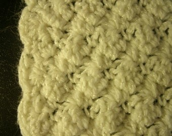 A beautiful soft white crochet blanket
