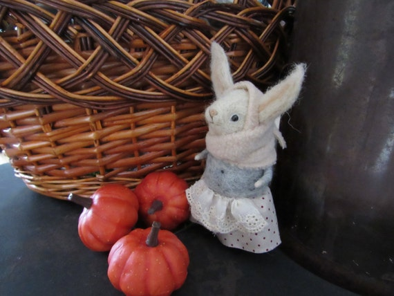 Little bunnies in coats and hats Bunnies from wool Positive animals Handmade