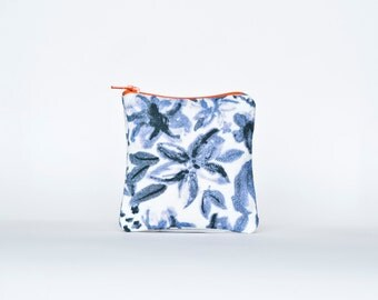 OASIS: Floral painterly pattern printed linen pouch with contrasting zip. Blue, Orange.
