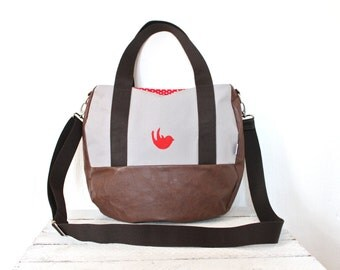 Large shoulder bag made of canvas and faux leather with red bird motif