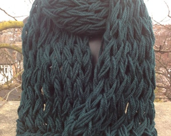 Super chunky, oversized hand, arm knitted scarf, shrug, wrap in gorgeous bottle green