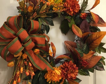 Fall grapevine wreath, Deep orange and green bow, Fall leaves, Fall colors on grapevine wreath, Fall flowers and leaves, Fall mums