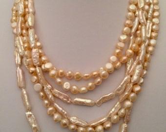 Multi strand mix of freshwater and biwa pink pearls
