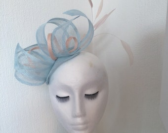 Pale blue peach pink sinnamay sunamay fascinator hat for ascot wedding epsom derby ladies day feathers