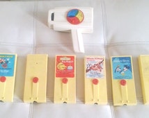 Vintage 1970's Fisher Price Movie Viewer + 6 Cartridges: Disney, Sesame Street