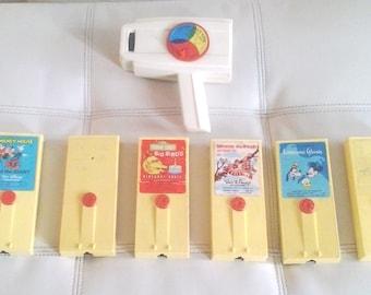 Vintage 1970's Fisher Price Movie Viewer + 6 Cartridges: Disney, Sesame Street