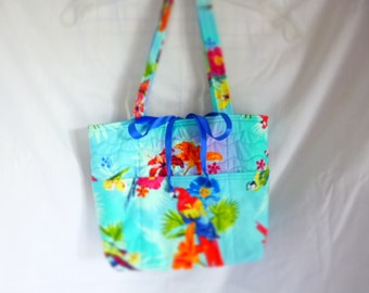 Quilted tote with outside pockets
