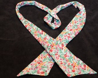 """Floral print skinny scarf in orange, pink, and blue 2"""" x 58"""" long"""