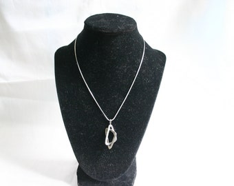 Vintage silver tone necklace with silver pendant.  Very Pretty.