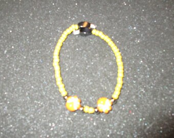 Yellow puppy paws magnetic bracelet.