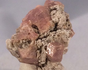 Cluster of Terminated Grossular Pink Garnets in Original White Rhyolite Matrix