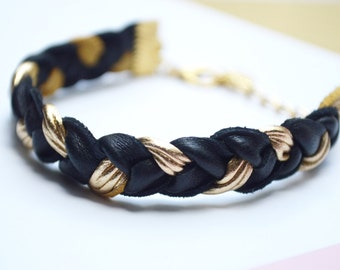 Black braided strap, leather lamb and fine gilded brass