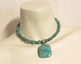Blue green ceramic pendant with turquoise beads