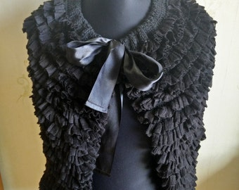 Black knit capelet with ruffles