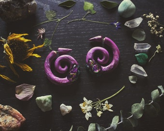 Handcrafted fake plugs, polymer clay, recycled material.