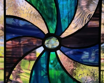 Green, Blue, Purple and clear stained glass pin wheel sun-catcher.