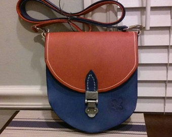 Orange and navy blue crossbody bag made with 100% leather