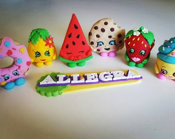 6 x Shopkins cake toppers plus name plaque