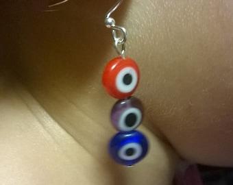 three colored eye bead earrings