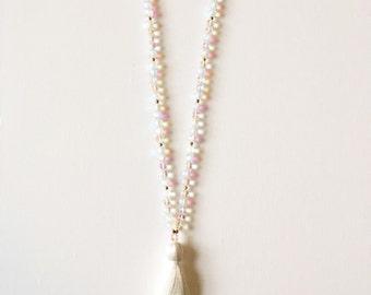 Iridescent glass beads with tassel