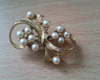 faux pearl brooch