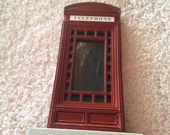 Cute British telephone booth photo frame