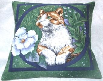 Pretty kitty and flower in garden cushion