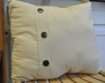 Tan Teastain Pillow with Black Buttons