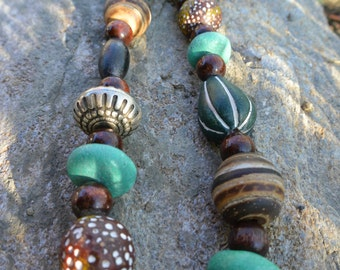 Necklace of wooden beads, silver beads and stones