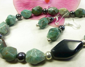 Faceted Jasper set with Hematite