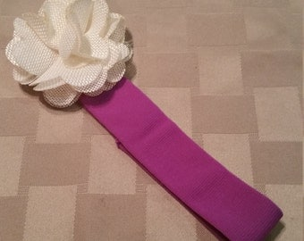 childs dark purple headband with white flower