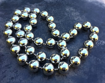Silver mirror ball necklace, statement strand of seamless, reflective large glassy metallic balls. Festive and lively!