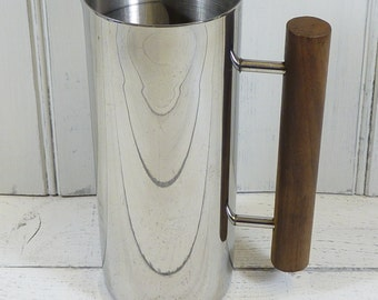 Vinage French 'Degrenne' stainless steel water jug with wooden handle.