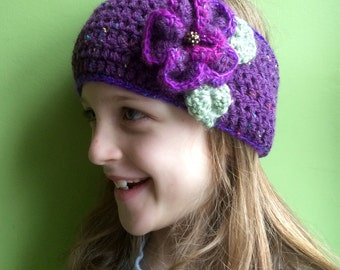 Crochet flower headband/ ear warmer in jazzy purple fleck and glitter yarn. Keep your ears snug as a bug this winter