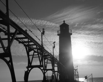 Black and white Grand Haven sunset lighthouse along the pier, Pure Michigan