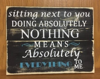 Sitting next to you doing nothing