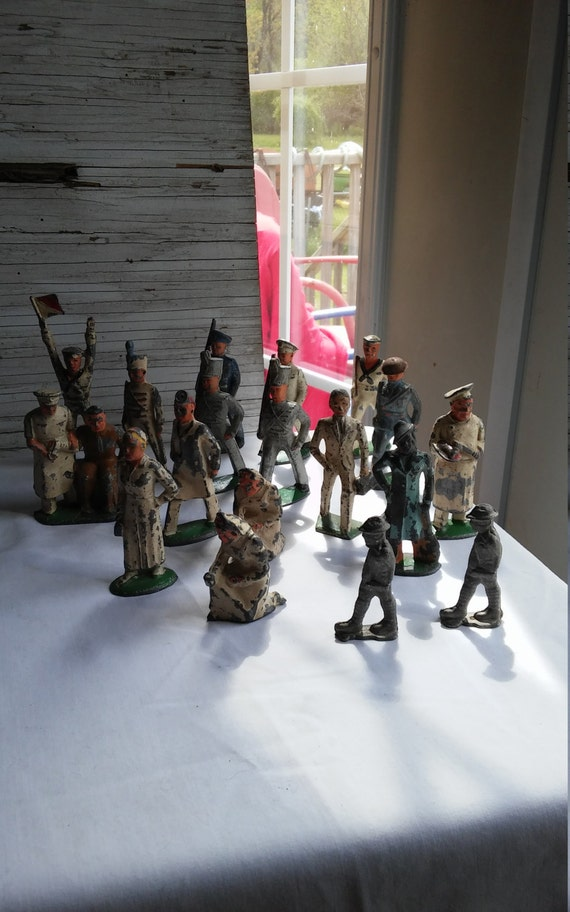 18 Vintage Lead Figurines Depicting Different Walks of Life Including Military, Hospital and day-to-day.