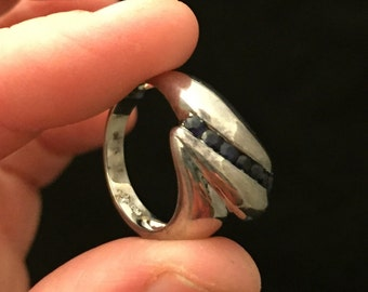 Sterling silver ring with blue sapphires.