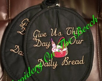 Pot Holders Give Us This Day Our Daily Bread embroidery design on them