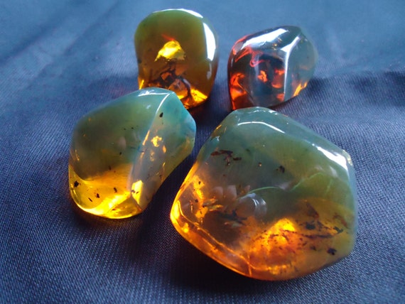 Amber lot of four pieces - Nice cognac like colour - Mexican amber 93 gr