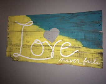 Handpainted reclaimed wood look sign