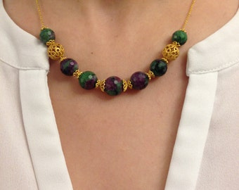 Necklace made of faceted zoisite and 18 K Gold