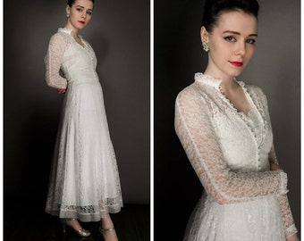 Vintage 40's lace wedding dress and long sleeved lace jacket, approx size 8 or a  small 10, I have matched it with a  beautiful  40's slip.