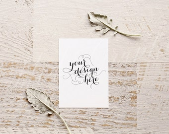 Styled stock photography - wedding stationery mock up, card mock up, soft frosted leaves, white card - Hight resolution JPG