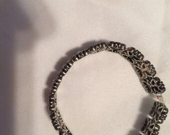 Silver jeweled stretch bracelet.
