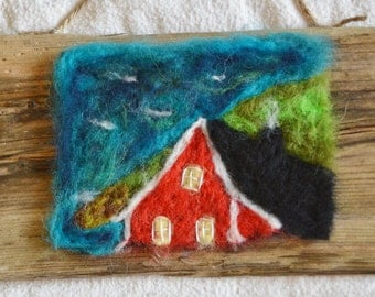 Folk art needle felted image of rad house on a hill by the sea