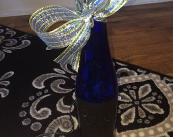 Cobalt wine bottle with lights and ribbon
