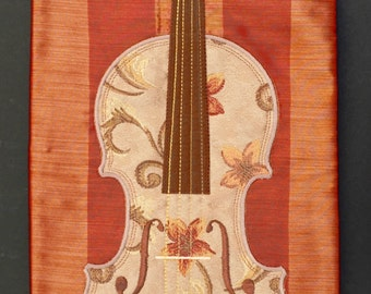 Brocade on silk, violin blanket in red and gold