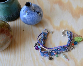 Handmade silver plated bracelet with recycle textile mixed with beads in bohemian style.
