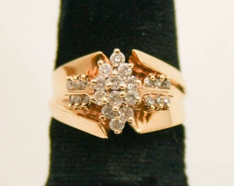 Diamond cluster in yellow gold ring size 7
